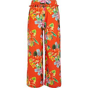 Orange, geblümte Hose mit weitem Beinschnitt