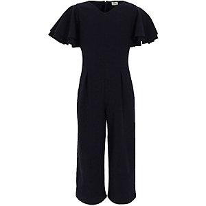 Marineblauwe jumpsuit met broekrok en ruches