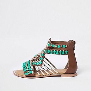 Turquoise verfraaide sandalen met T-bandje en siersteentjes