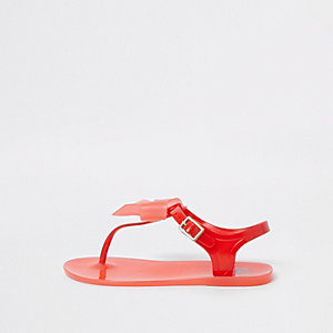 Rode jelly sandalen met strik en diamantjes