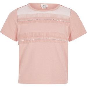 Lichtroze T-shirt met diamantjes en rand van mesh voor meisjes