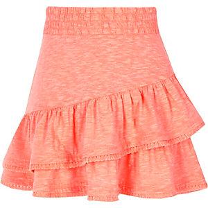 Roze rok met kwastjes aan de zoom voor meisjes