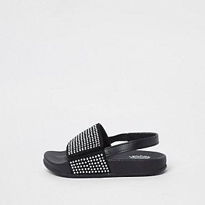 Schwarze Slipper mit Ziersteinchen