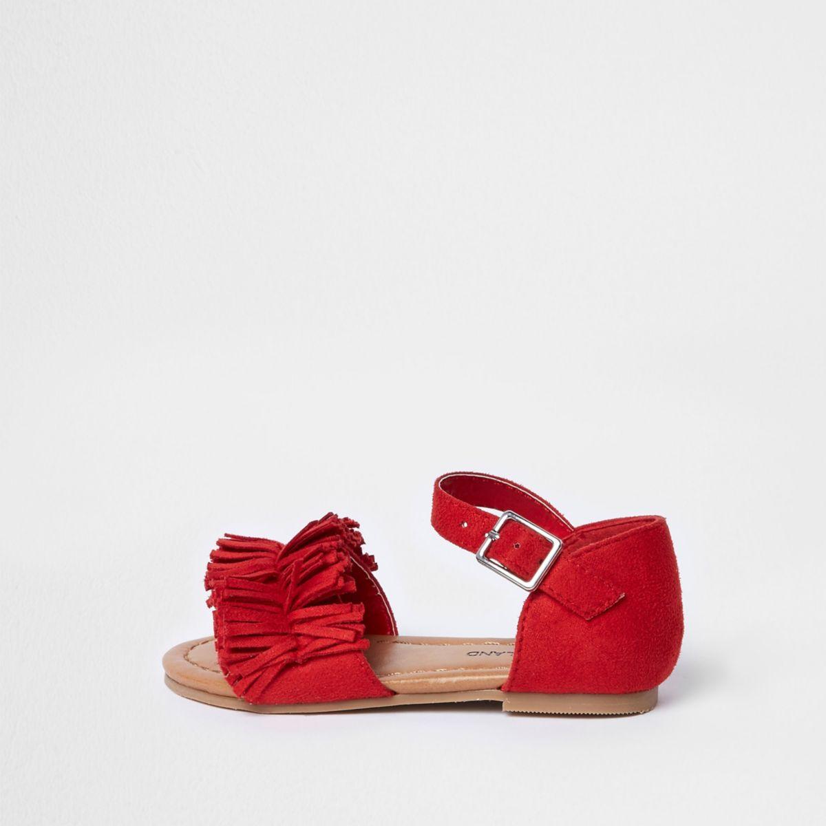 Rote Sandalen mit Fransen