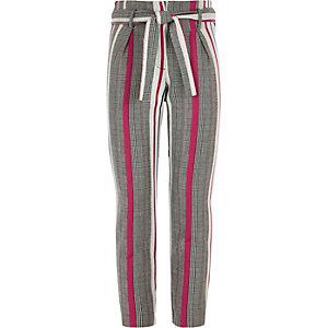 Grijze met roze geruite smaltoelopende broek voor meisjes