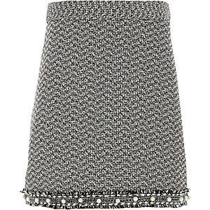 Zwarte bouclé rok met parels aan de zoom voor meisjes