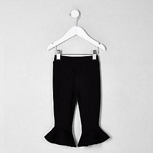 Mini - Zwarte legging met ruches en pompons aan de zoom voor meisjes