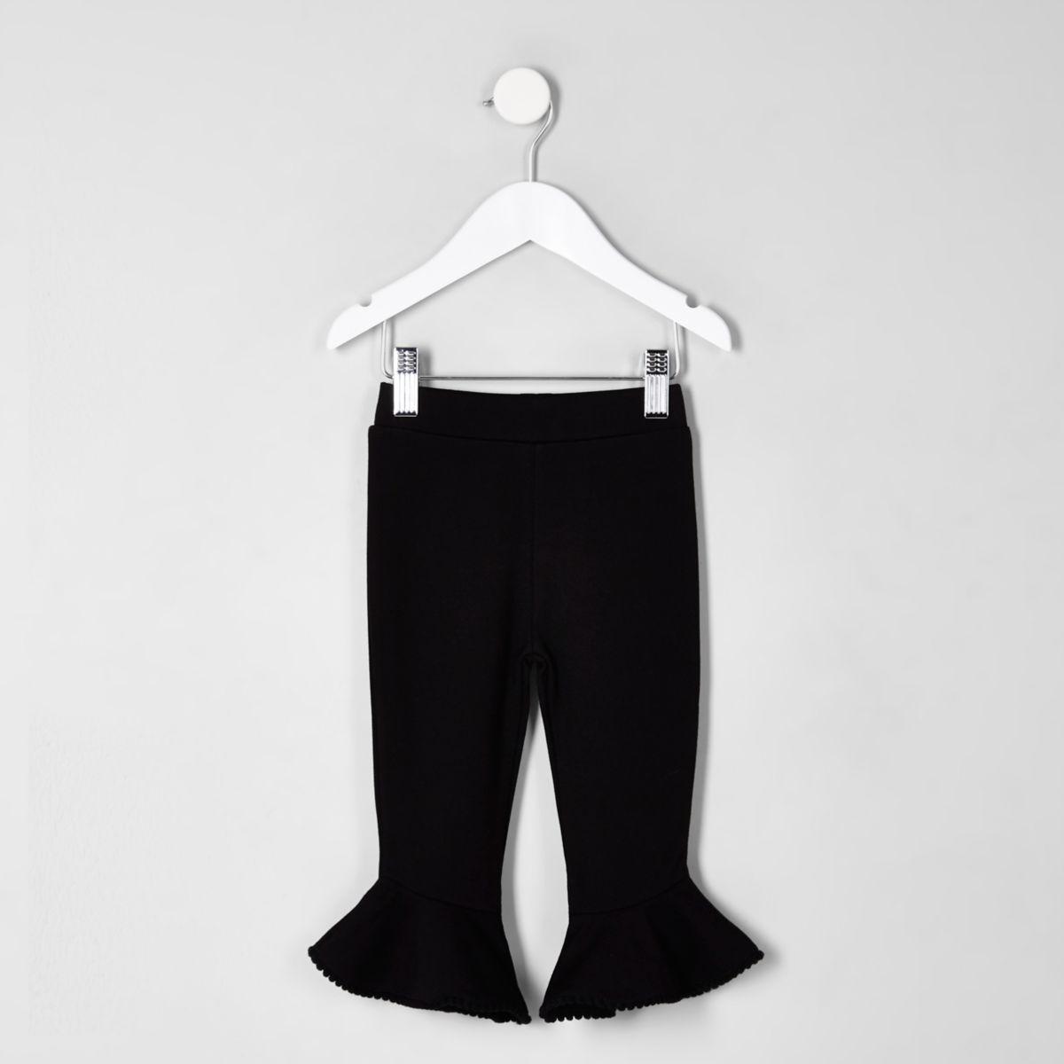 Mini girls black pom pom hem frill leggings