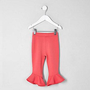 Mini - Roze legging met pompons aan de zoom en ruches voor meisjes