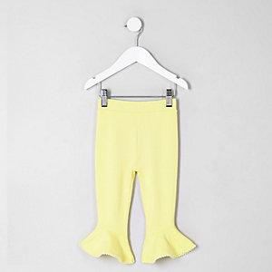 Legging jaune à pompons et ourlet à volant mini fille