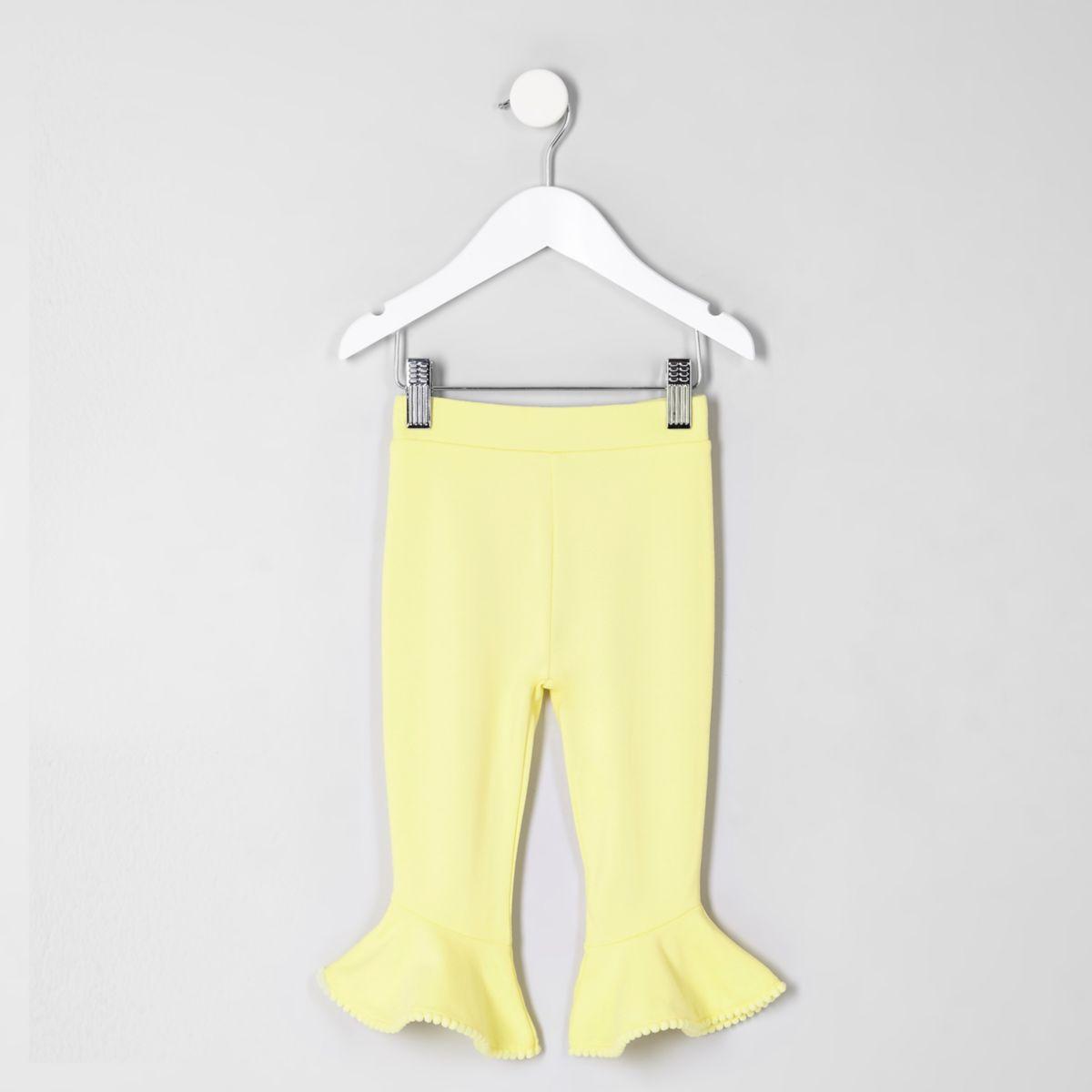 Mini girls yellow pom pom frill hem leggings