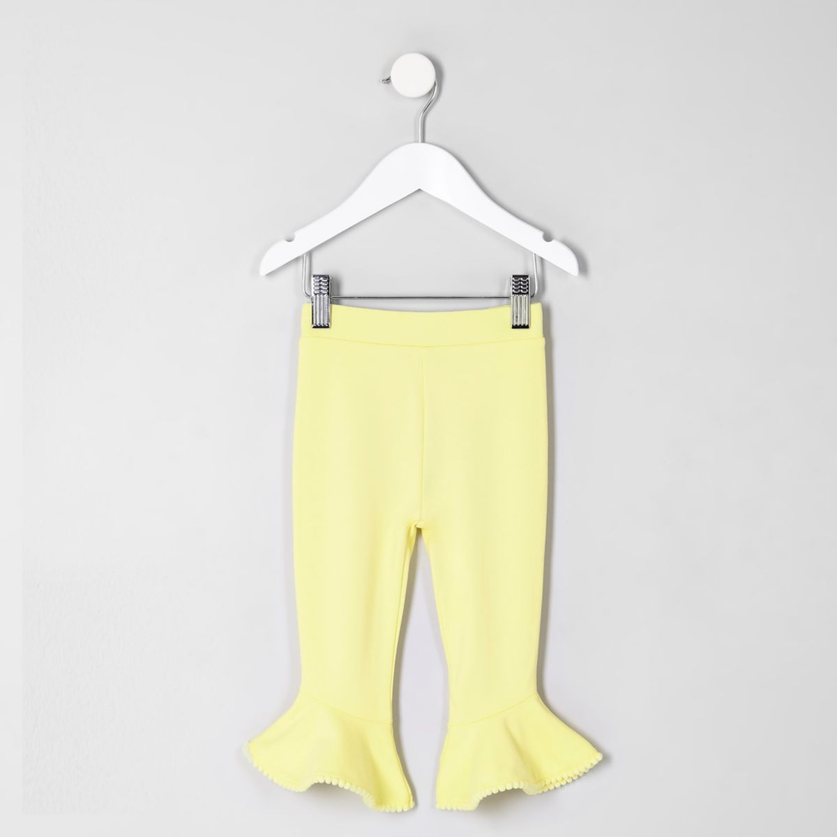 Mini girls yellow pom pom frill hem leggings