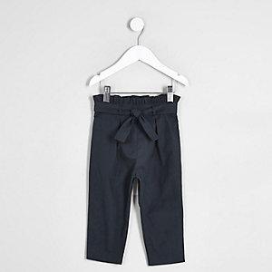 Pantalon bleu marine avec nœud devant mini fille