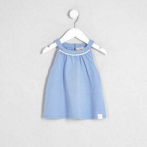 Mini girls blue pom pom trim trapeze top