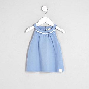 Top trapèze bleu bordé de pompons mini fille