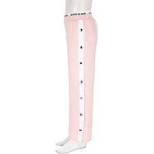 Pantalon RI Active rose avec boutons pression sur les côtés pour fille