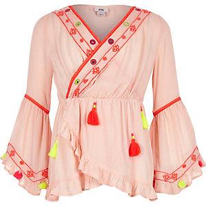 Roze tuniek met pompons en ruches aan de zoom voor meisjes