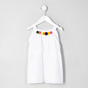 Robe trapèze blanche avec bordure à pompons mini fille
