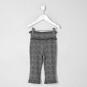 Pantalon gris à carreaux avec ourlet à volant mini fille