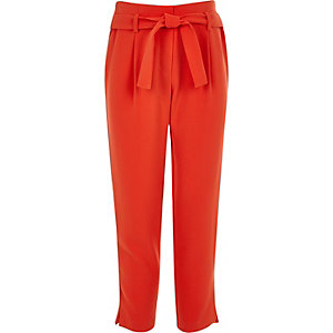 Girls red tie waist trousers