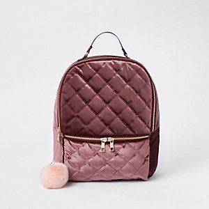 Girls dark red quilted pom pom backpack