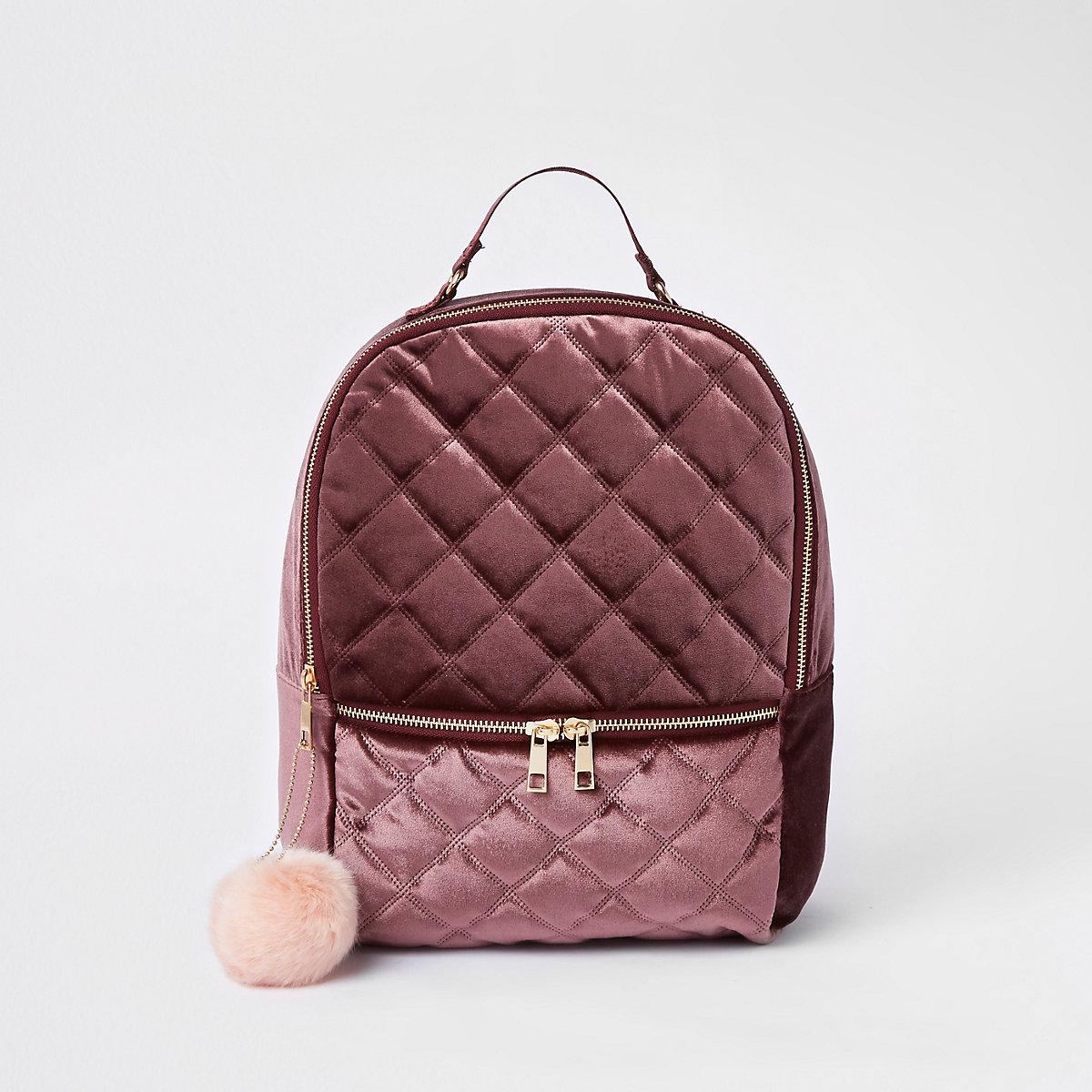 Girls dark red quilted pom pom backpack