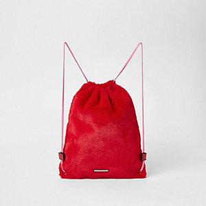 Rode rugzak met trekkoord en imitatiebont voor meisjes