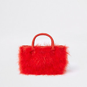 Rode handtas met veren en zij-inzetten voor meisjes