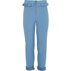 Blauwe smaltoelopende broek met rits en ruches voor meisjes