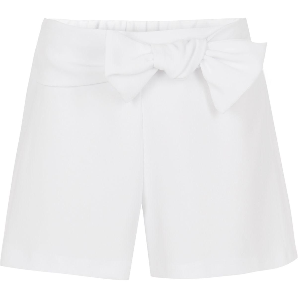 Girls white bow front shorts