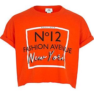 Oranje cropped T-shirt met 'fashion avenue'-print voor meisjes