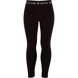 Schwarze Leggings mit #RI-Bund