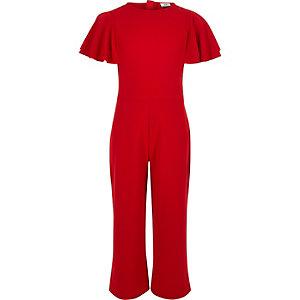 Rode jumpsuit met broekrok en franje aan de mouwen voor meisjes