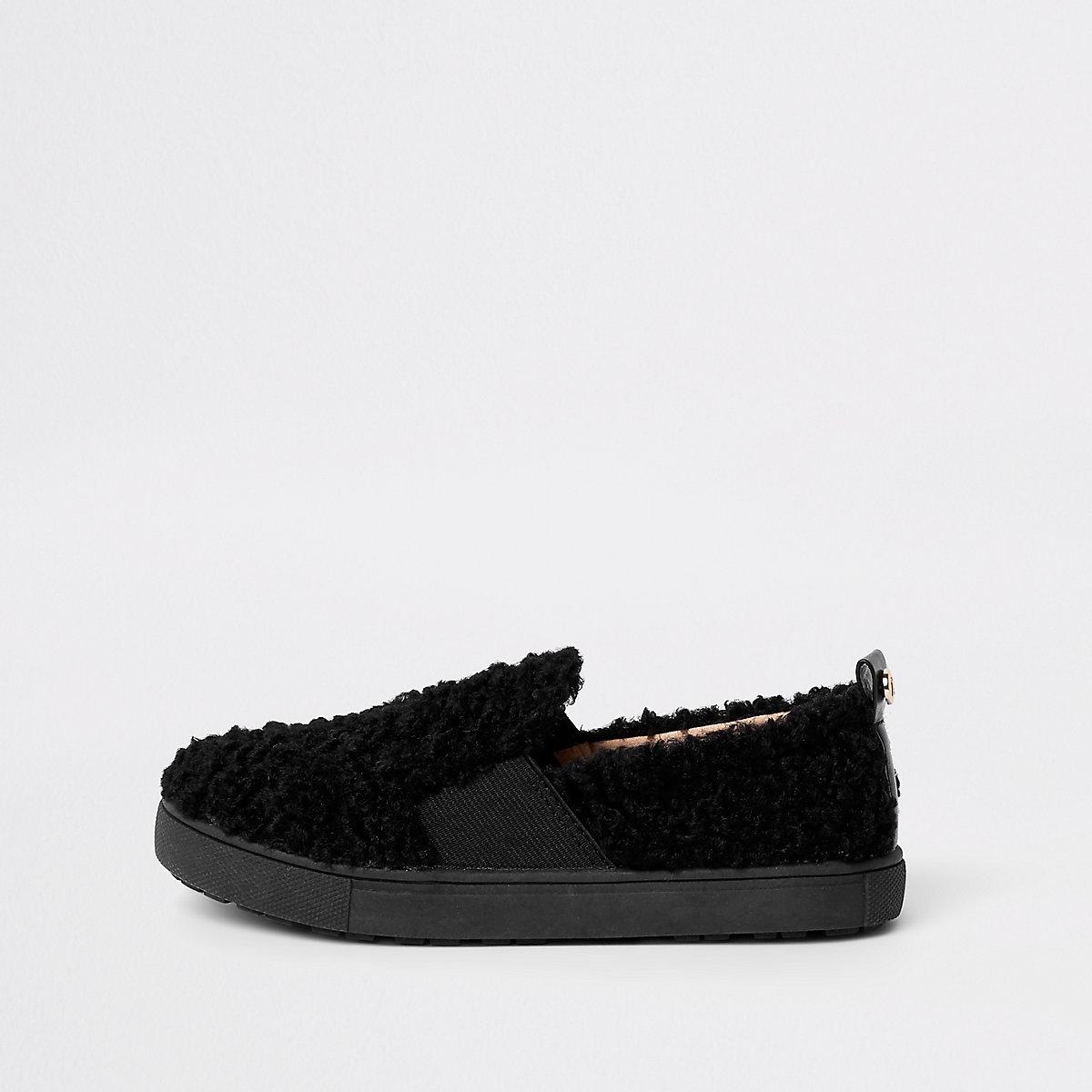Girls black faux fur slip on plimsolls