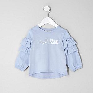 Mini - Blauwe top met 'always amazing'-print en ruches voor meisjes
