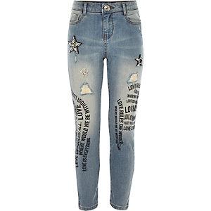 Girls blue embellished graffiti jeans