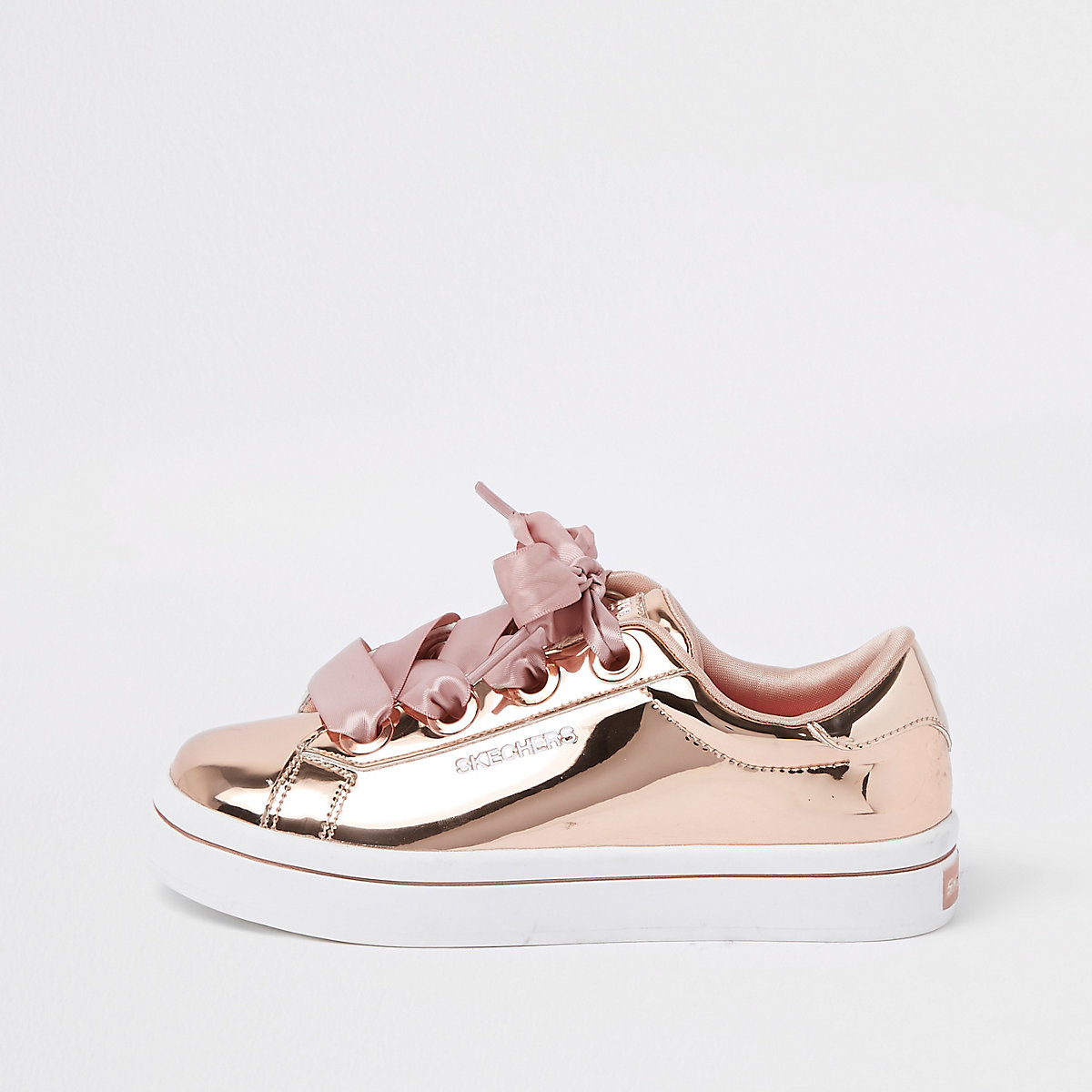 Girls Skechers rose gold low top trainers