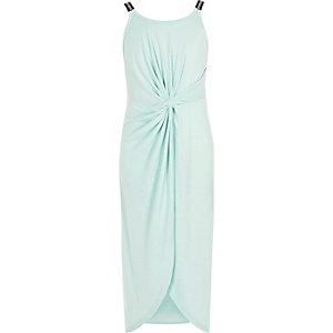 RI – Robe mi-longue vert clair nouée sur le devant pour fille