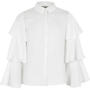 Girls cream frill sleeve shirt