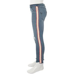 Molly - Blauwe ripped skinny jeans met roze streep voor meisjes