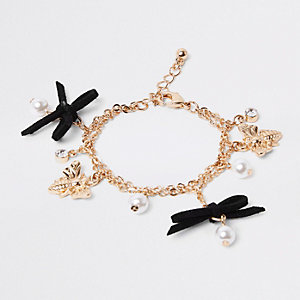 Girls black bee and bow charm bracelet