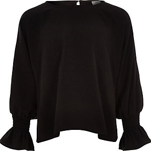 Black long split sleeve top