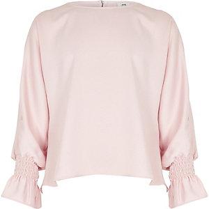 Roze lange top met split in de mouwen