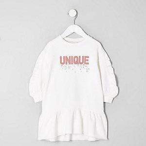 Mini - Crème trui-jurk met 'Unique'-print en ruches voor meisjes