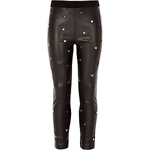 Girls black studded leather look leggings