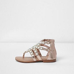 Sandales dorées effet cage à entredoigt ornées de pierreries mini fille