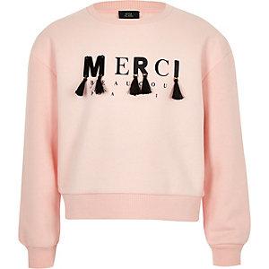 Lichtroze ruimvallende sweatshirt met 'merci'-print voor meisjes