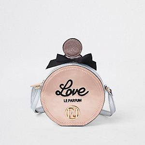 Sac bandoulière rose style parfum avec logo RI pour fille