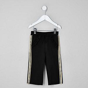 Pantalon de jogging en néoprène noir à bandes latérales et volants mini fille