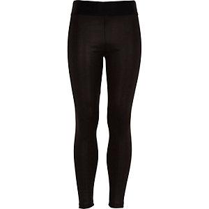 Girls black coated wet look leggings